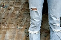 View of torn jeans worn by a woman