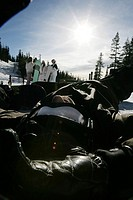 Man with ski goggles on lying on a ski slope