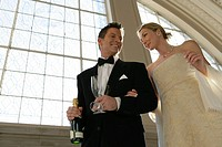 Mature couple with champagne (thumbnail)