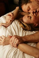 Mature couple making love