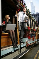 Two people on a trolley car