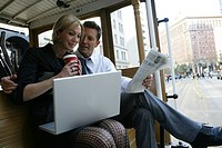 Mature couple commuting on a trolley car (thumbnail)