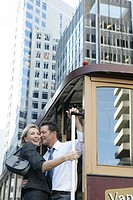 Mature couple riding a street car (thumbnail)