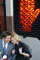 Aerial view of couple near a walk sign (thumbnail)