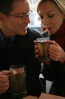 Couple enjoying drinks