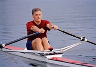 Man rowing in single scull