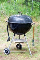 Weber charcoal grill with hanging brush and spatula  Danbury Wisconsin USA