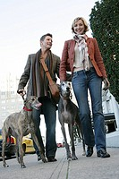 Couple walking dogs (thumbnail)
