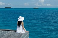 Womon Sitting on Ocean, Maldives