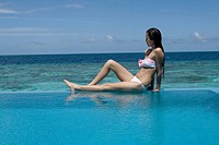 Woman on swimmingpool, Maldives, Indian Ocean