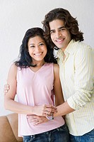 Portrait of a young couple standing together and smiling