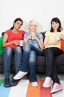 Three female friends on a sofa
