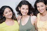 Portrait of three young woman smiling