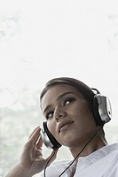 Businesswoman listening to music