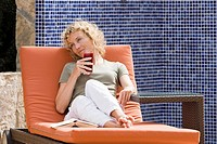 A woman relaxing on a sun lounger (thumbnail)