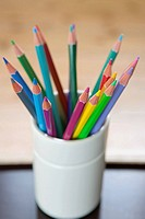 Coloured pencils in a desk tidy