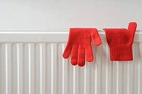 Gloves drying on a radiator