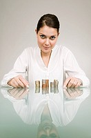 Woman with stacks of coins