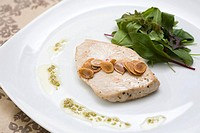 Fish with almonds and salad leaves