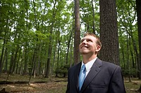 Young businessman in forest