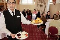 UK, England, Lancashire, Manchester, Heaton Park, Heaton Hall, Orangery 1820, Edwardian tea, waiter, scones,