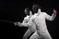 two men exercising fencing
