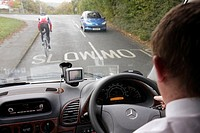 UK, England, North Yorkshire, Addington, tour coach bus driver, bicyclist, cyclist, road, traffic,