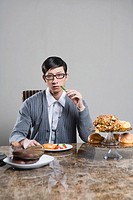 Young man sitting at breakfast table