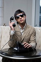 a fashionable man calling
