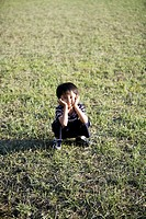 Portrait of a boy crouching