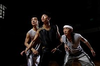 Three basketball player playing basketball