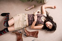 a fashionable woman lying on the floor