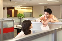 Colleagues talking in an office