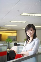 Young woman standing at office