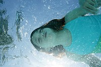 Little girl swimming underwater (thumbnail)