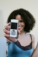 Woman holding a cellphone/blackberry up to camera