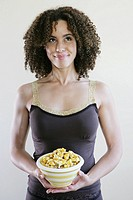 Woman smiling holding a bowl of popcorn