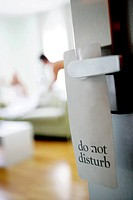 Do Not Disturb sign with couple in background