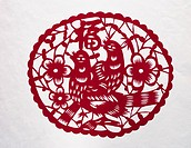 Paper-cut of two pies, flowers and Chinese characters