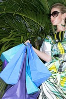 Fashionable woman with shopping bags