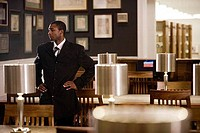 Contemplative businessman standing in an office
