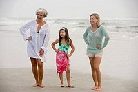 Grandmother enjoying with her daughter and granddaughter at the beach