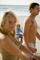 Family riding bicycle at the beach
