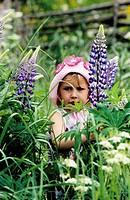 Girl standing in a field, Dala_Floda, Dalarna, Sweden