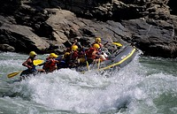 People enjoying the excitement of river rafting