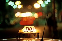 Close up of lighted Taxi Parisien sign