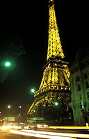 Eiffel Tower at night with lights on in Paris, France
