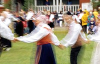 Blurred motion of people dancing outdoors