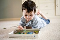 Toddler playing. Young boy playing with a jigsaw puzzle.