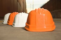 Close_up of hardhats at a commercial dock